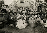 Ojibwa congregation in decorated wigwam, 1915? - 1925?