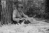 Ojibwa [?] man building a birch bark canoe, 1 of 9, 1937?