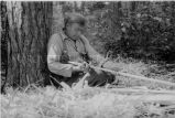 Ojibwa [?] man building a birch bark canoe, 2 of 9, 1937?