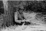 Ojibwa [?] man building a birch bark canoe, 3 of 9, 1937?
