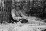 Ojibwa [?] man building a birch bark canoe, 4 of 9, 1937?