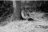 Ojibwa [?] man building a birch bark canoe, 5 of 9, 1937?