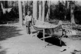 Ojibwa [?] man building a birch bark canoe, 6 of 9, 1937?