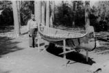 Ojibwa [?] man building a birch bark canoe, 7 of 9, 1937?