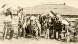 Wolf dancers in front of dance lodge, 1923