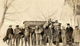 St. Stephen's basketball team about to depart for game, 1920?