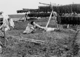 Eskimo woman blowing up bladder, 1949
