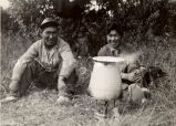 Men making tea in camp, 1936?