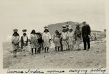 Acoma women carrying pottery, 1933