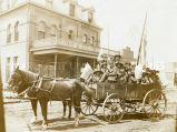 Students from St. Patrick's Mission in wagon on July 4th, 1903