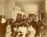 Sisters of Mercy and girls in sewing class, 1900? - 1920?