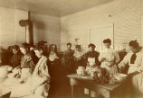 Girls with nun in kitchen at St. Mary's Academy, 1900? - 1920?