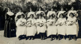 Religious sister with girls' mandolin and guitar club, 1916