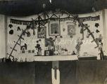 Interior of native home with shrine, 1916?