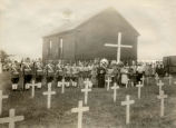 Congregation near church cemetery for flag raising, 1932