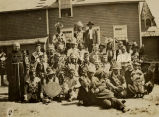 Franciscan priests and Bishop Joseph N. Koudelka with large Ojibwa group in traditional dress, n.d.