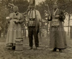 Ojibwa male and two females in mix of traditional and contemporary dress, n.d.