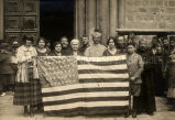Osage Indian group and Archbishop Daeger with U.S. flag outside of Church of the Holy Sepulcher,...