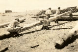 Zia Indians trimming logs, 1920? - 1922?