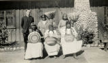 Rev. Casey and women parishioners with baskets, n.d.