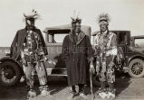 Three grass dancers on smoking break, 1929