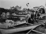 Docking canoes with wild rice, n.d.