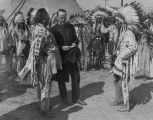 Archbishop Hugh Curley and men in native dress, 1930