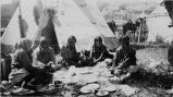 Women dining in front of tipi, 1922
