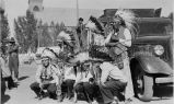 Men in native dress with musical instruments, 1926? - 1942?
