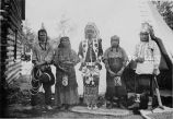 Group in native dress by tipi, 1924