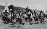 Salish men dancing wearing cloth dress & war bonnets, 1938?