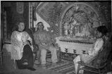 Rev. Regis Darpel, O.F.M. with Toya family at Santo Niño altar, 1948