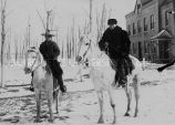 Rev. Dinand and boy on horseback, 1911? - 1925?