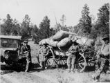 Men with automobile and wagon loaded with wool, n.d.