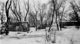 Log homestead in snow, 1941?