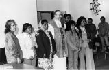 Rev. McGrath with parishoners, 1988