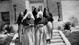 Oblate Sisters of the Blessed Sacrament on school steps, 1938