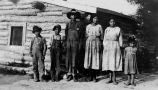 Nakota children outside log home, 1922?