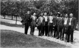 Rev. McNamara, S.J. and George Malone with Indian men at Layman's Retreat, 1930