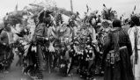 Fancy dancers in native dress with beads, breastplates & war bonnets, 1947