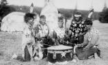 Men in native dress posed around drum at Apostle Island Pageant, 1924?
